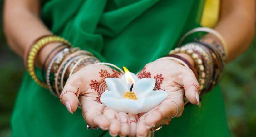 Beautiful woman in traditional Muslim Indian wedding green sari